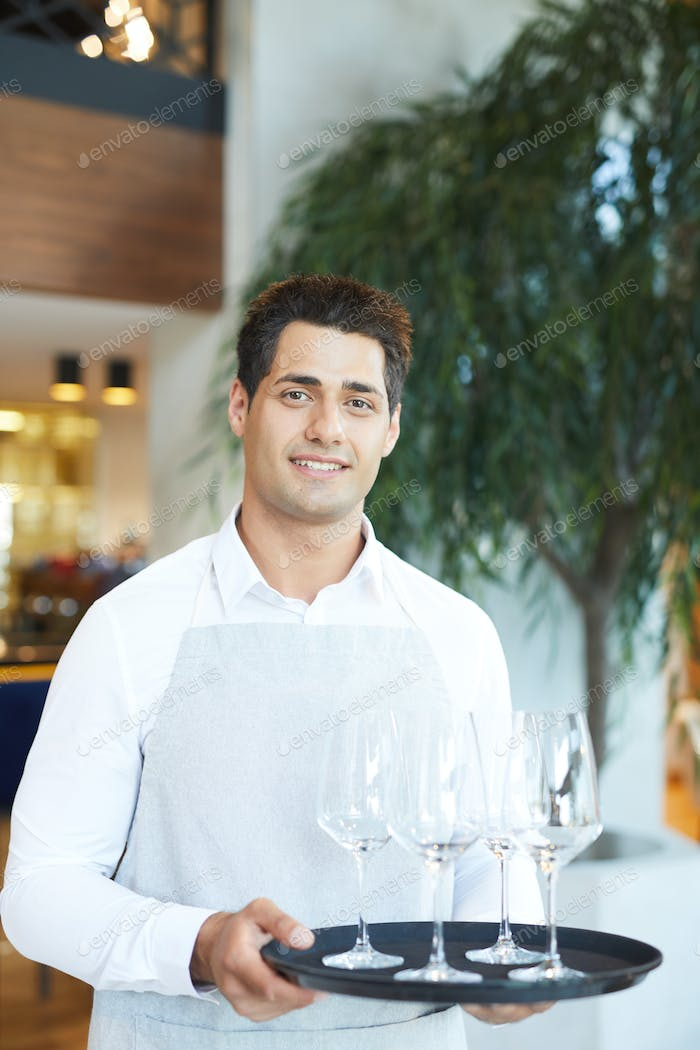 Waiter with tray of wineglasses