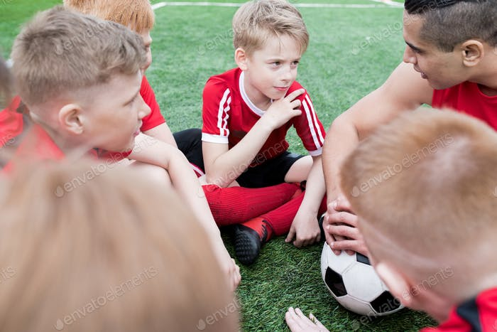 Boys Listening to Football Coach