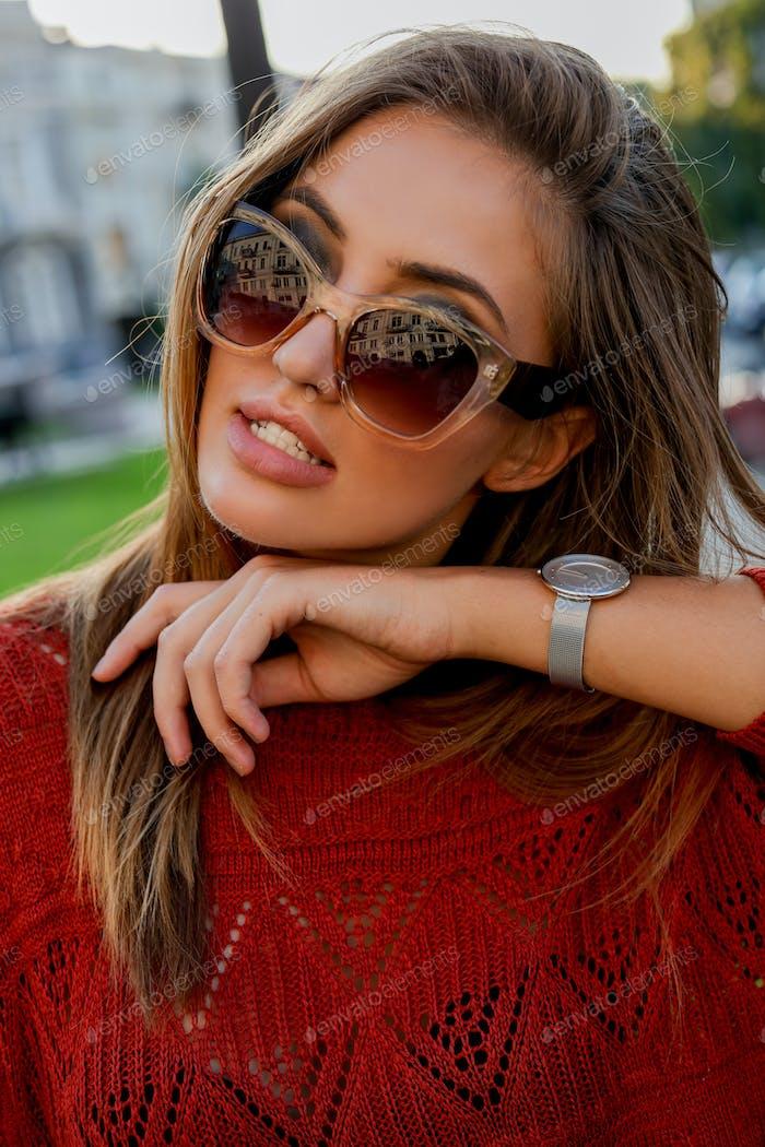 Close up  portrait of beautiful european woman in sunglasses  posing outdoor.