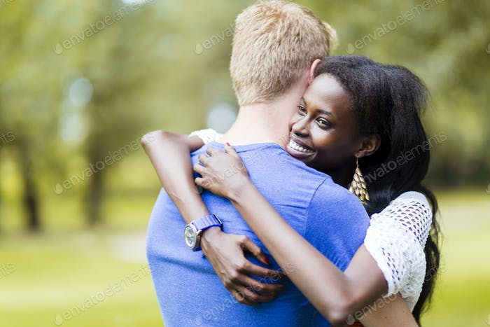 Couple in love hugging peacfully outdoors