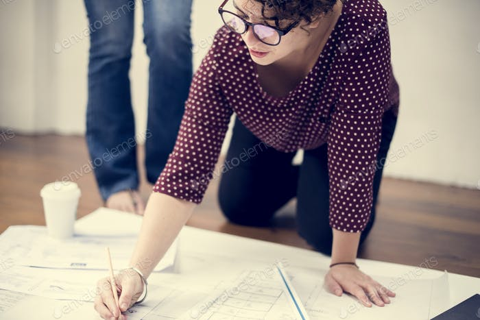 Woman working on drawing a plan