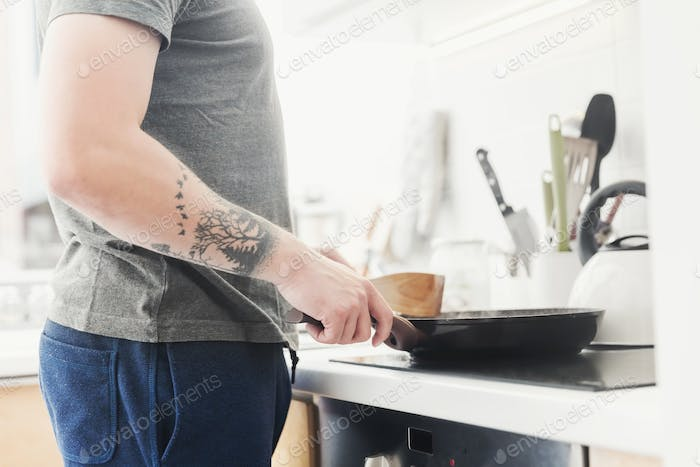 Man frying a meal in the morning