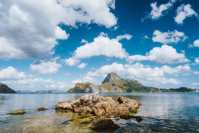 El Nido bay with rocky coast and Cadlao island on sunny day, Palawan, Philippines
