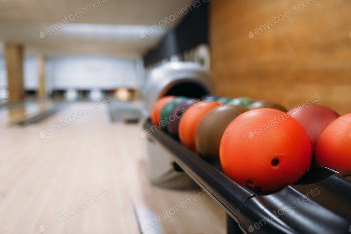 Color bowling balls in feeder, bowl game concept
