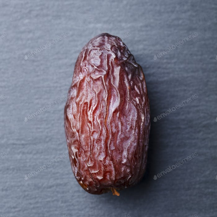 Fresh Medjool Dates. Slate Stone Background. Close up. Top view.