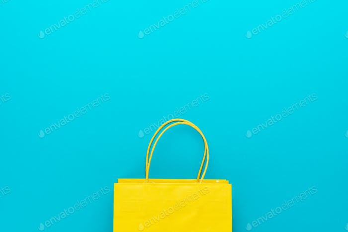 Shopping Paper Bag On Blue Background With Copy Space Summer Sale Concept