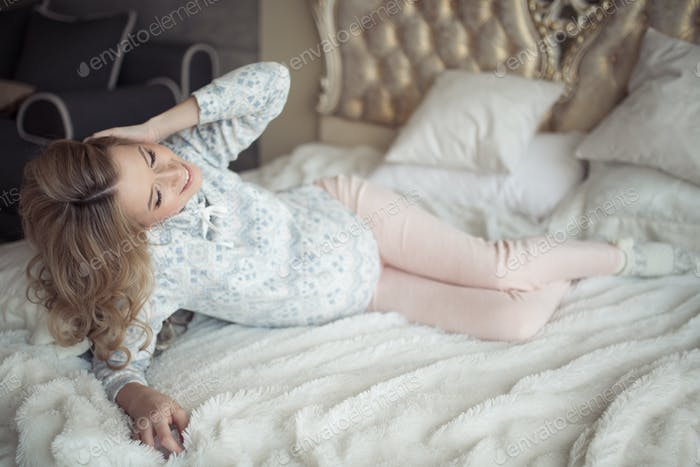 Beautiful Pregnant Woman In Cozy Clothes.