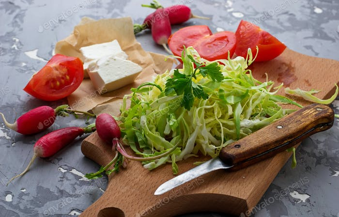 Ingredient for salad cabbage, radish, tomato and feta
