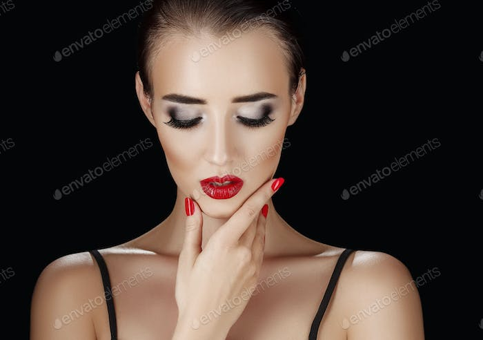 Beauty Woman with Perfect Makeup. Beautiful Professional Holiday Make-up. Red Pink Lips