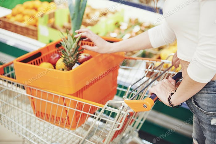 A woman chooses fresh food in a supermarket