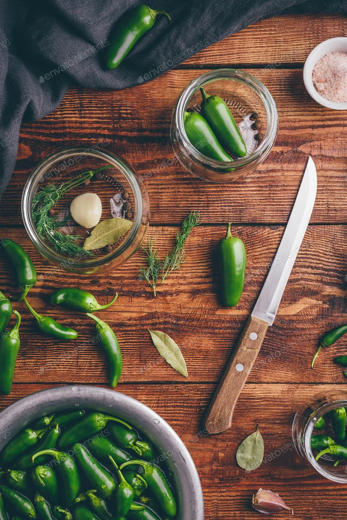Canned Jalapeno Peppers, Garlic And Glass Jars.