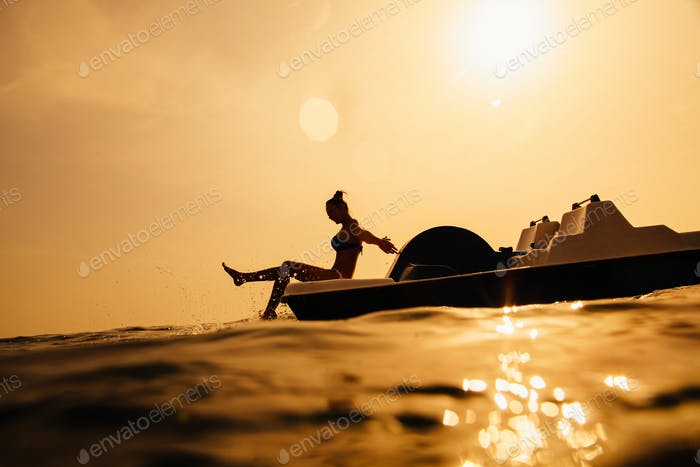 girl on paddle boat with sunlight