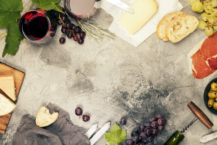 Wine and snack set. Grey marble background, top view, copy space