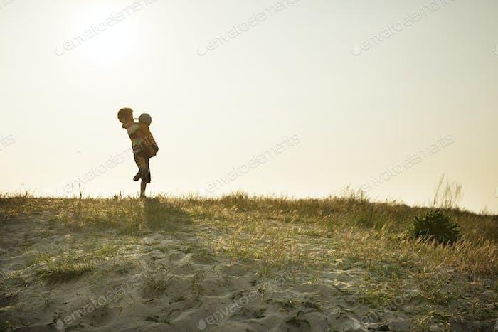 Children (4-5, 10-11) playing on beach