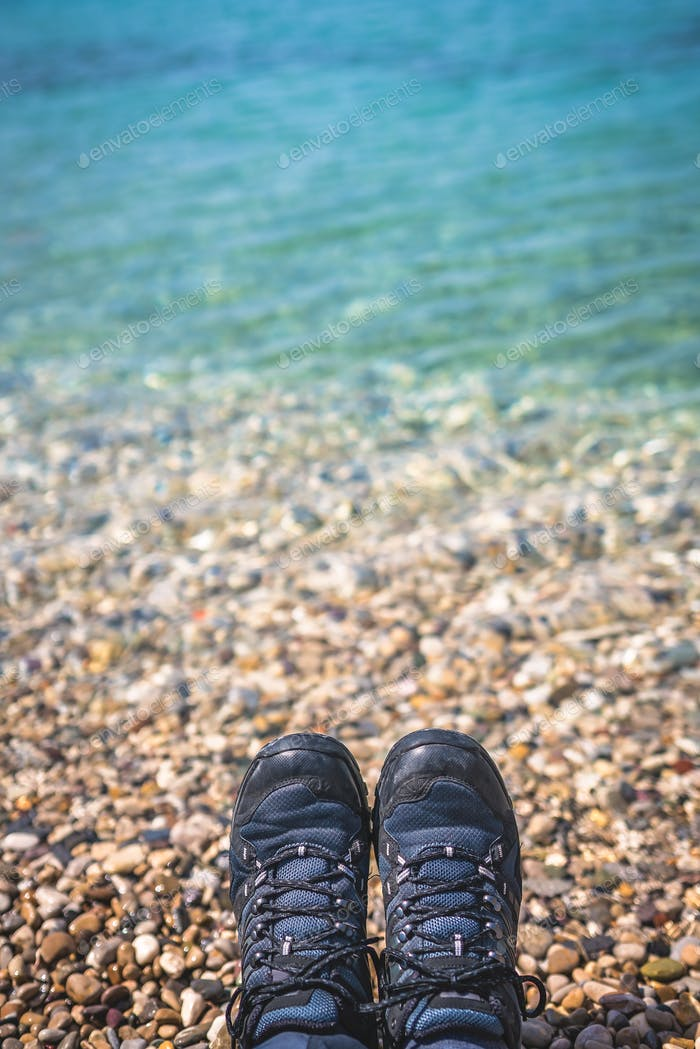 Trekker feet on the stony beach