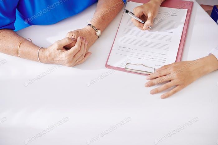 Doctor filling medical history