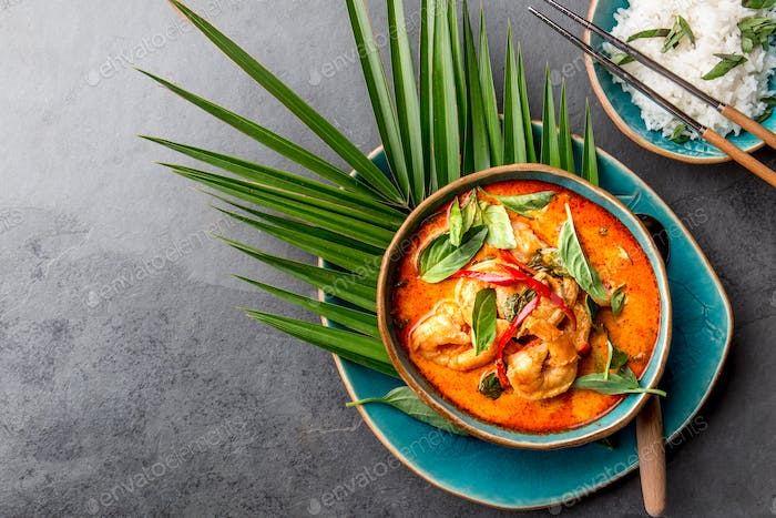 THAI SHRIMPS RED CURRY. Thailand Thai tradition red curry soup with shrimps prawns and coconut milk