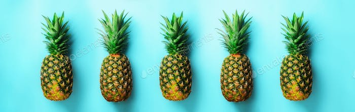 Bright pineapple pattern for minimal style. Top View. Pop art design, creative concept. Copy Space