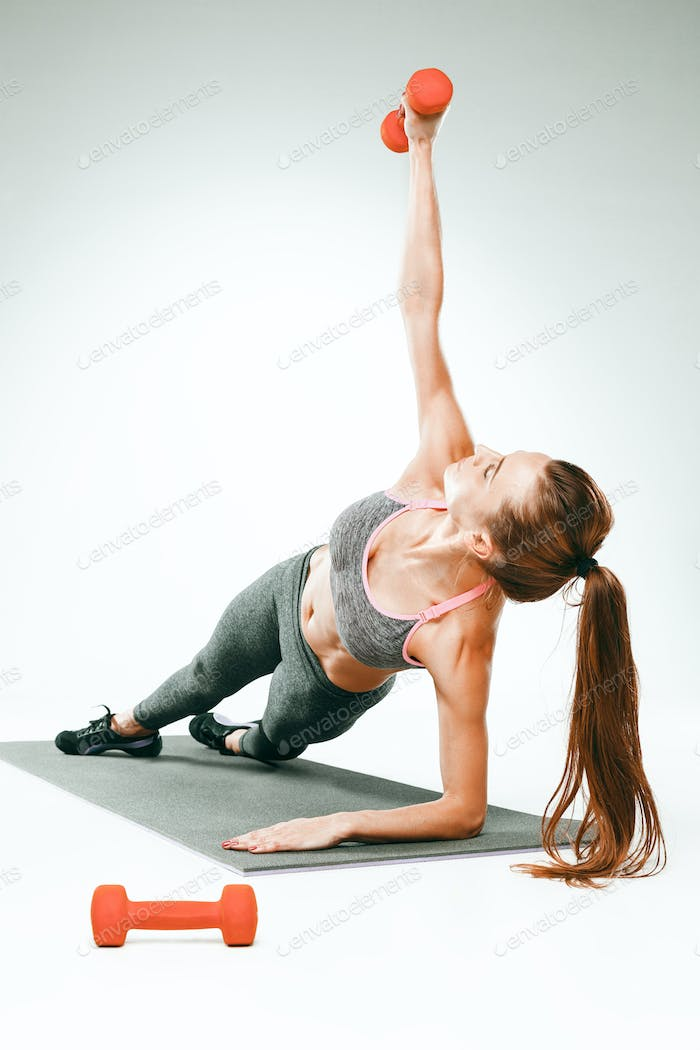 Beautiful slim brunette doing some stretching exercises