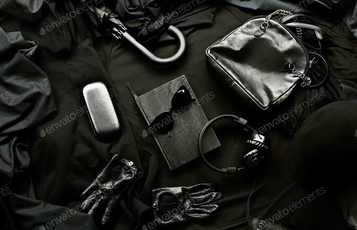 Set of trendy stylish black accessories and clothes on a black background