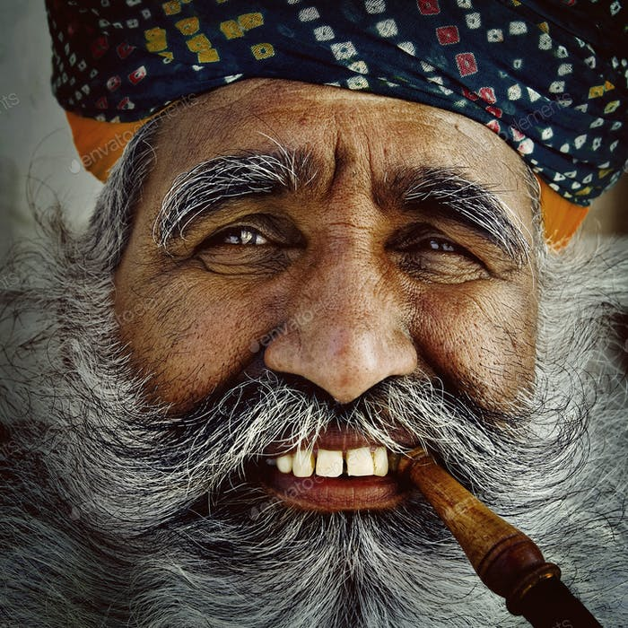 India Man Smoking a Pipe Concept