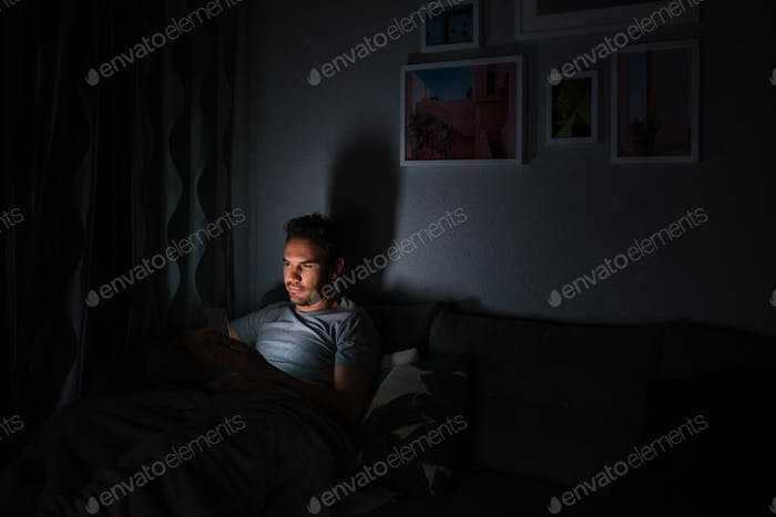 Man in pajamas with a mobile phone