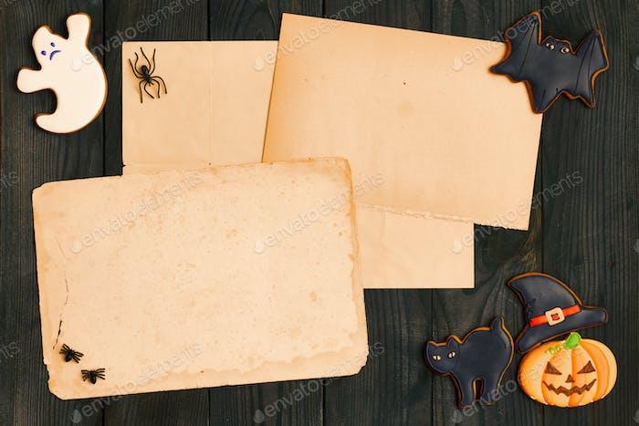 Halloween invitation over wooden background