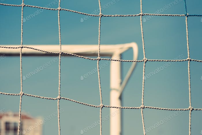 European football or soccer goal defocussed in background