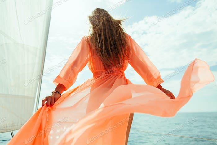 woman sail on yacht sea cruise vacation