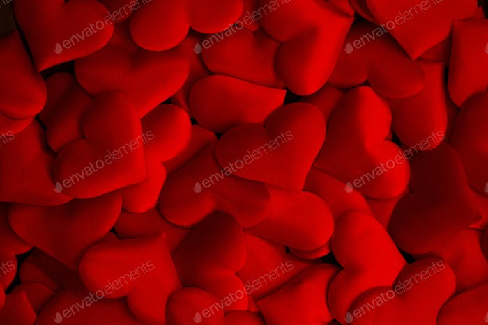 romantic background with red silk hearts