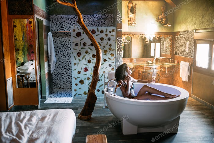 Young woman relaxing in the hydro massage bath