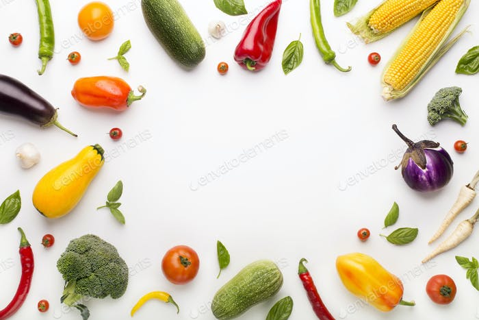 Round frame of fresh and healthy vegetables on white
