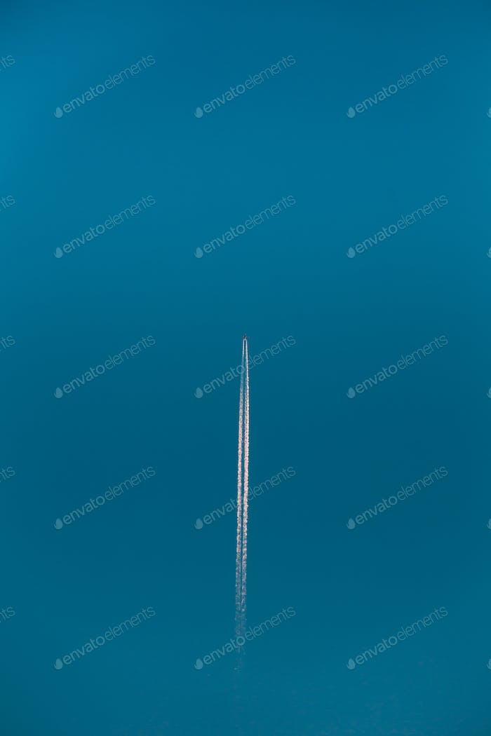 Contrail In Blue Sky. Aircraft Plane In Clear Sunny Sky Backgrou
