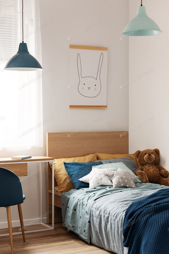 Pastel blue and mint accents in cozy children's bedroom