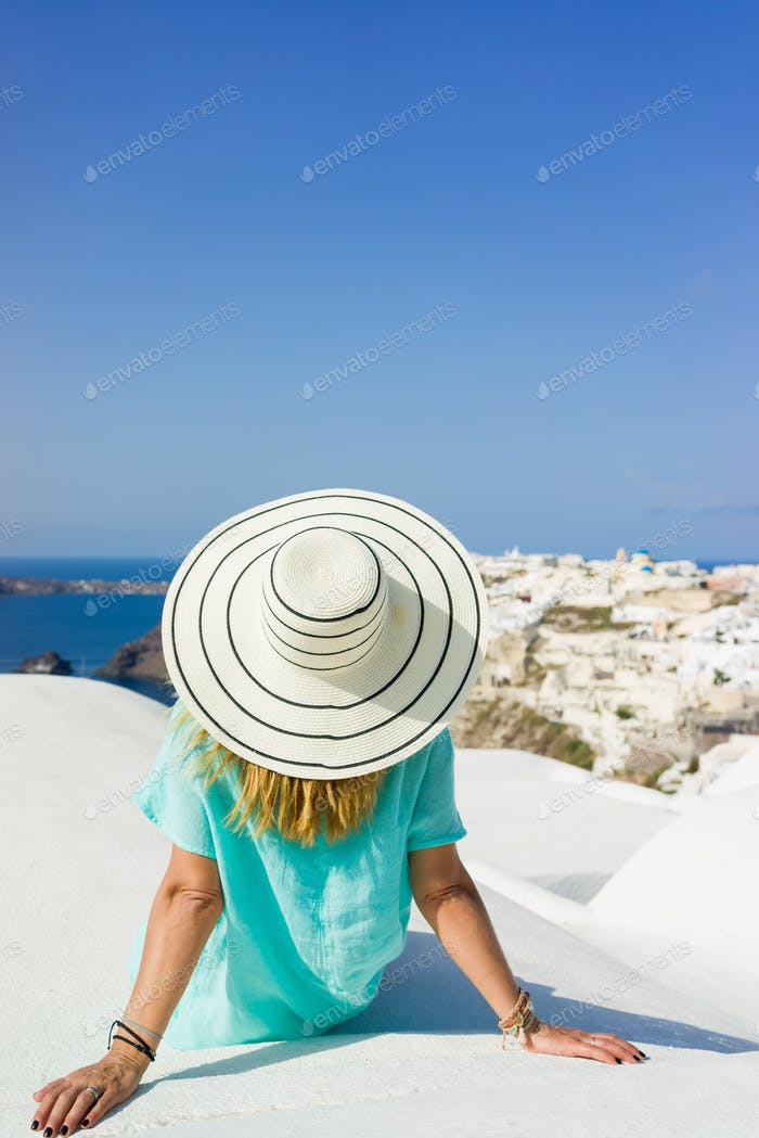 Woman on holidays in Santorini Greece