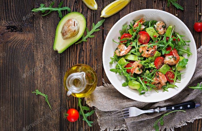 Fresh salad bowl with shrimp, tomato, avocado and arugula