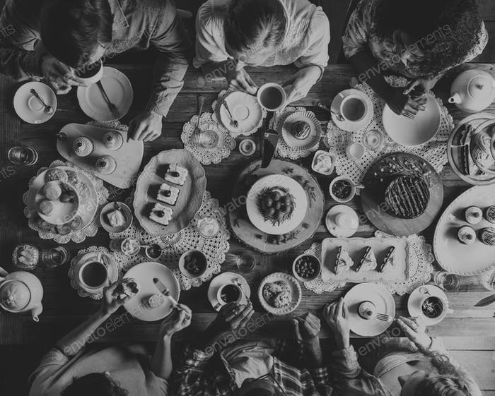 People having food together in black and white