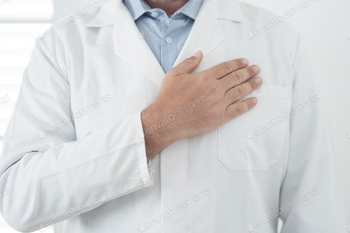Unrecognizable man doctor portrait with man on heart - cardiologist professional job