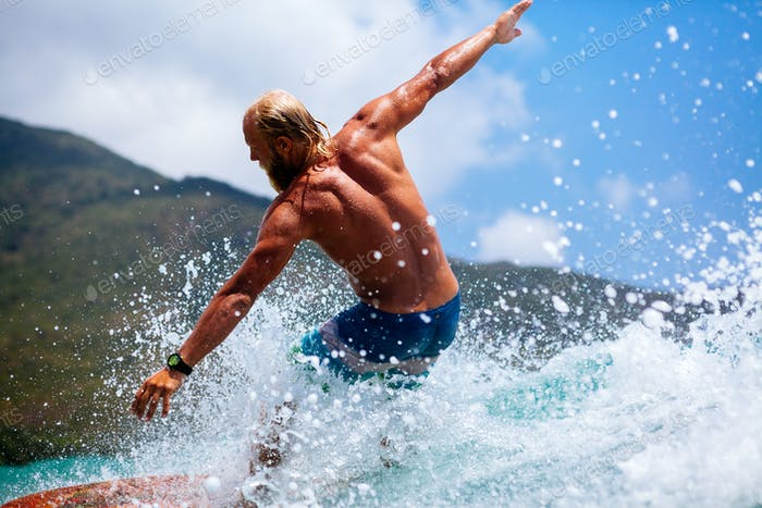 man surfing actively
