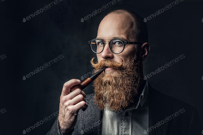 A man smoking pipe over grey background.