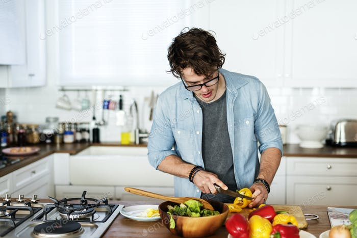 Caucasian man cooking in the kitchen