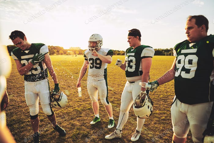 Young American football players having fun during a practice session