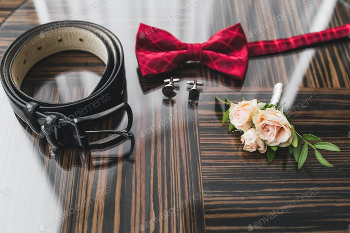 Male wedding set - red bow tie, boutonniere with roses, classic leather belt and cufflinks