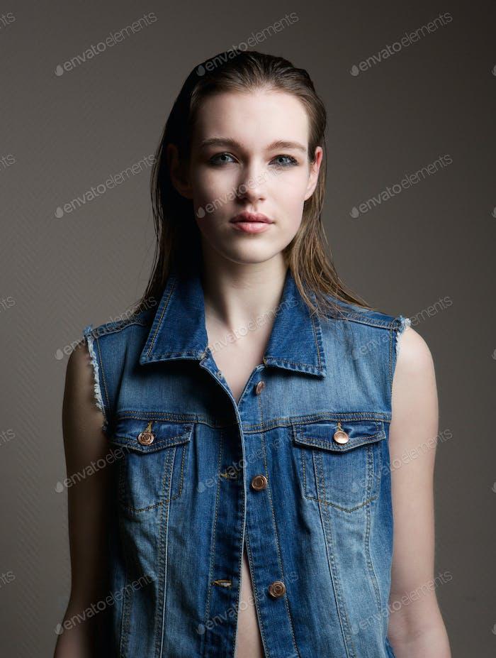 Model in blue denim jeans jacket