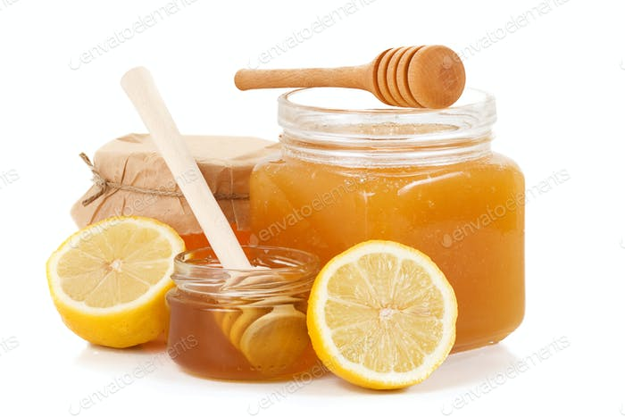 pot of honey and sliced lemon