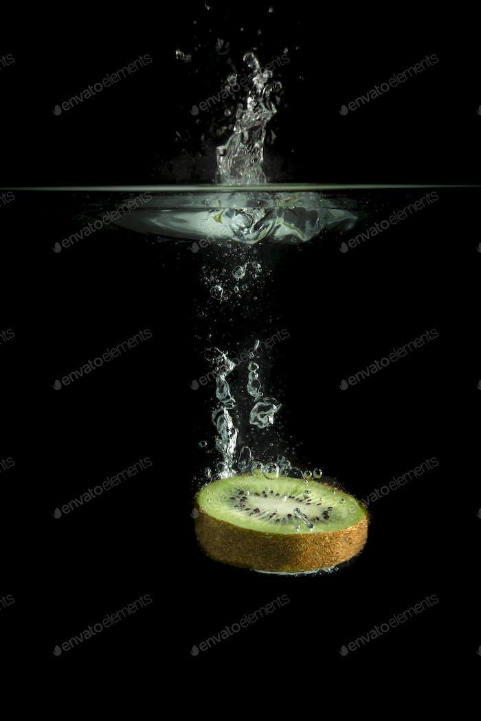 Kiwi fruit falls in water