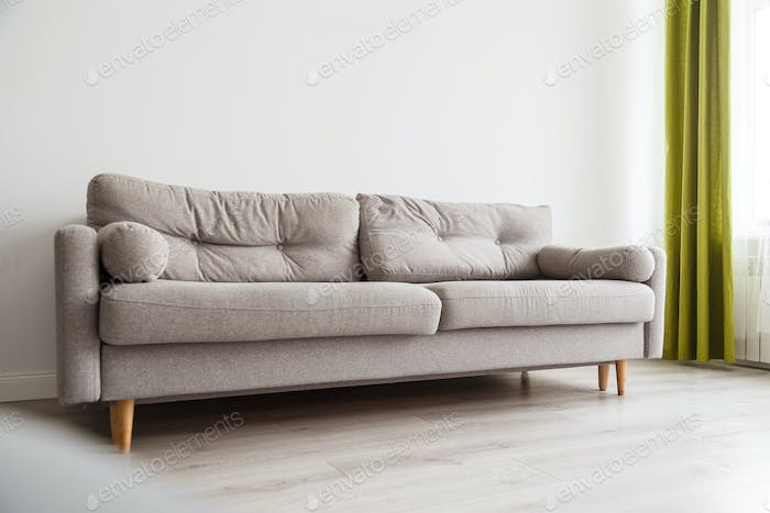 Grey sofa in monochromatic living room