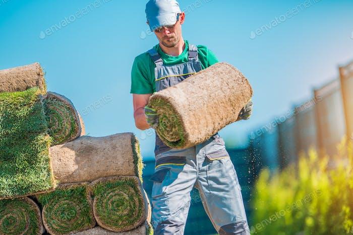 Gardener with Piece of Turf