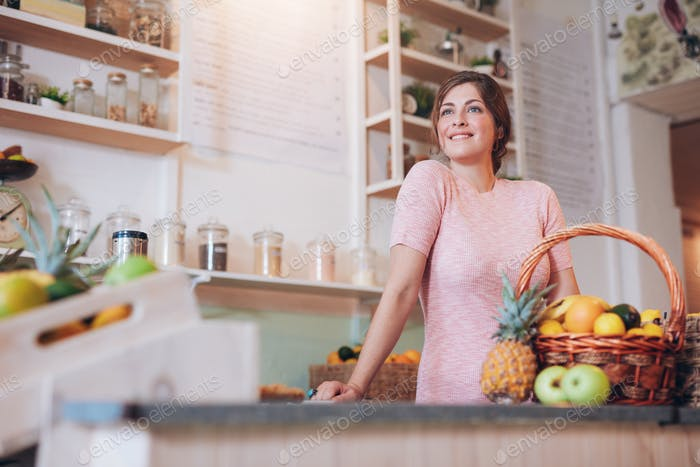 Young woman working at a juice bar
