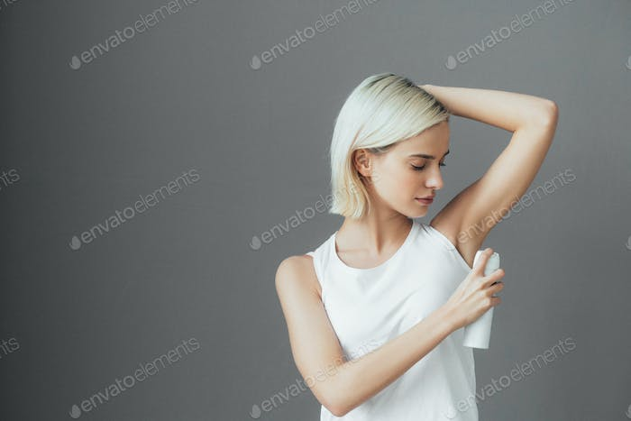 Deodorant spray woman portrait